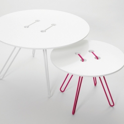 WIS design's Twine Tables - inspired by one of the oldest ways of attaching – with a needle and thread. The wire is twined through the table top, and becomes legs as well as upholding construction.