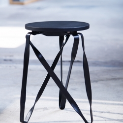 Twist-Grille stool. Twisted metal is a characteristic feature of the traditional Taiwanese window grill. The legs of the stool are composed of three triangular elements, to which the twisting of the metal adds structural strength.