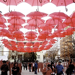 Over 400 umbrellas covered a pedestrian mall in downtown Talca, Chile, resulting in a colorful public space.