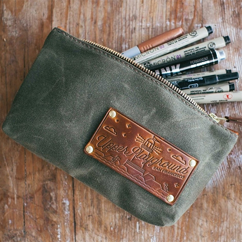 OROX Leather Co. x Upper Playground - Handmade Pencil Pouch with Waterproof Waxed Canvas & Essex Leather Accents. Love the minimal illustrations of SF in the leather.