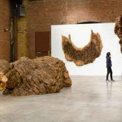 Large-scale sculpture by artist Ursula von Rydingsvard at the Sculpture Center.