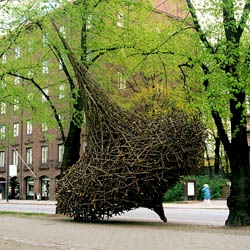 "Vagrant, Willow sculture . ""A heap of rough, trimmed tree trunks, nicely piled up, is in itself a signal of man's presence and his wish to influence the surrounding nature - to mark it"", says finnish sculptor Jaakko Pernu."