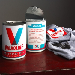 Promotional t-shirt packaging from Valvoline Oil, each retro 50's style can contains one pre-oiled t-shirt. By Eric Stevens  for Borders Perrin Norrander.