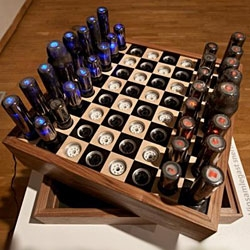 "The ""Chess Set For Tesla,"" by Paul Fryer, uses 32 vacuum tubes and 64 plugs to ensure that those pieces don't tip over during play."