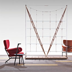 The Veliero bookshelf by Franco Albini made from two brass-tipped masts of tapering wood that rest together on one point and shelves floating under hangers of thin steel rods.