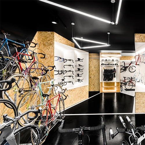 """VÈLO7 designed by Modelina Architekci. """"We are crazy about bicycles!"""" Stunning store design."""