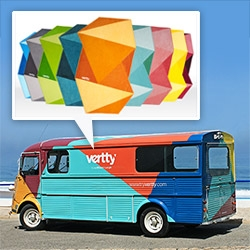 New beach towel brand Vertty is housing their showroom in a traveling bus that is outfitted with colorful triangles, paralleling the dynamic design of the vibrant towels.