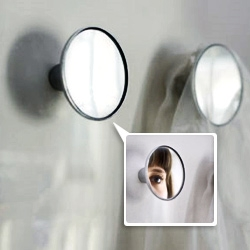 'Check' by Véronique Maire is a wall-hook and mirror for that last minute 'check'.
