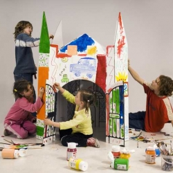 The castle is a play-house made of cardboard. It's interior is a life-size coloring page and its white exterior can be colored and decorated as per one's imagination. Kid's love it!