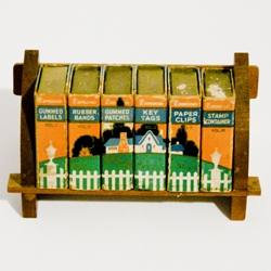 Around mid-century, Dennison's  company produced adorable sets of stationery supplies as though they were mini books in a home library.