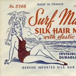 A collection of vintage hair net packaging.