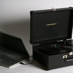 Forget the boombox, this is the summer of vinyl! This inexpensive portable record player hooks up to your computer and comes with a handy case for travel.
