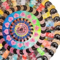 "Virginia Fleck's mandalas made from plastic bags ""analyze the activity of consumerism as a spiritual encounter."""