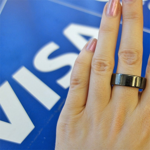 Engadget plays with VISA's new payment ring prototype. A minimal band with a secure microchip from Gemalto and an embedded antenna. Exterior is a black or white ceramic loop. Initial test group will be 45 Visa sponsored athletes at the olympics.