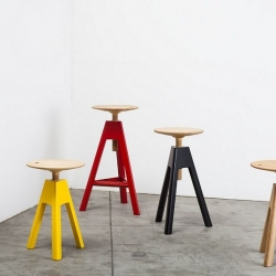 Vitos by Paolo Cappello is a three legged screw stool in natural and bright colours lacquered wood.