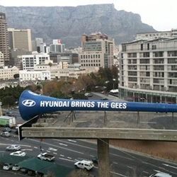 Hyundai and Jupiter Drawing Room, Cape Town have erected a 114-foot-long Vuvuzela on one of the unfinished flyover roads and attached several air horns to the mouth piece! (see video!)