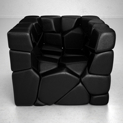 A vuzzle chair by Christopher Daniel consists of 59 small cushions. You can shape the chair by detaching cushions from the complete cube. Each cushion has magnets under the surface which hold the whole structure together.