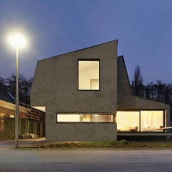 this house, by grosfeld van der velde architecten, in vianen, netherlands, the house is designed from the inside, as a succession of spaces where  each room has a special character and a different view of the landscape.