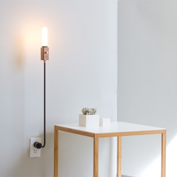 Wald Plug Lamp by Feltmark. floor lamp stripped to the most essential parts, then thoughtfully reassembled as a versatile lamp to fit any room.