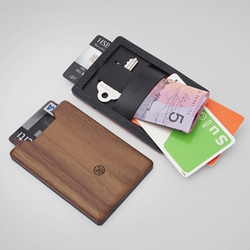 Union wallet is made from wood and elastomer. A slim minimalist wallet that combines the warmth of wood with functionality made possible by injection molded parts.