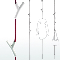 'WardRope' coat rack by Veronika Wildgruber and Susa Stofer. Porcelain hooks mounted on the rope cling to it effortlessly due to the friction between the two materials.