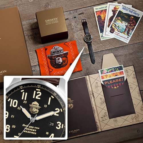 Filson Smokey The Bear Limited Edition Watch Set - complete with certificate of authenticity, a book, and six postcards of Smokey posters. Assembled in Detroit at the Shinola Watch Factory. Limited to 1000 pieces.
