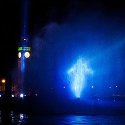 Watchmen: Dr. Manhattan Appears Over River Thames in a giant water projection.