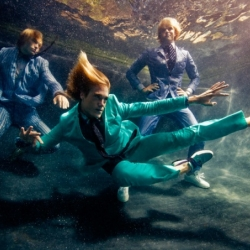 Photographer Michael Muller captured models underwater for an aquatic fashion editorial in VMan magazine.