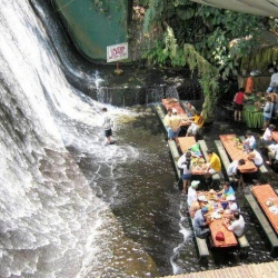 Waterfall Restaurant in the Village of Escudero, Philippines. Patrons eat right next to the breathtaking waterfall and have water flowing around their feet!