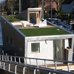 The Silberfisch Houseboat is a thoroughly modern floating home that also allows the flexibility of relocation on a whim and sports a 'green' roof planted with vegetation, producing zero emissions and utilising reclaimed wood where possible.