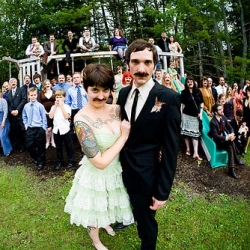I have yet to attend a mustachioed wedding party, but fake mustaches at wedding do look fun.  check out more pics via offbeat bride.