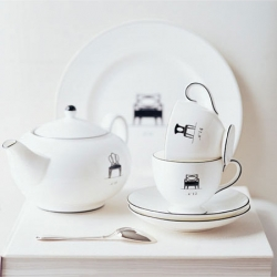 Musical Chairs Collection features silhouettes of Barbara Barry's  favorite chair designs on crisp white china. This iconic range pays tribute to Barbara's success in furniture design.
