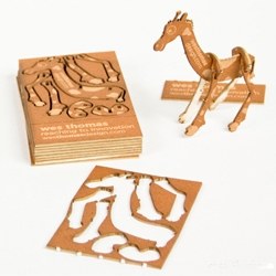Wes Thomas's laser cut business cards feature pop-out animals that can be quickly assembled to make a desktop buddy.
