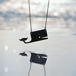 Super cute Emil Kozak locals only whale necklace - Reversible! White one side, walnut veneer the other.