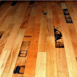McKay Flooring now offers reclaimed wood that's taken from old whiskey barrels, with planks carrying the emblazoned type and markings of the original barrels.