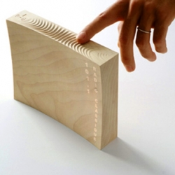 White Fruit Radio - Made of wood and controlled by running your fingers along the surface we love this new concept!