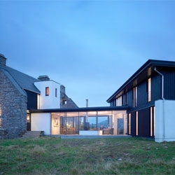 The White House on the Scottish Isle of Coll is a ruin that has been converted into a modern, eco-friendly home by William Tunnell Architecture.