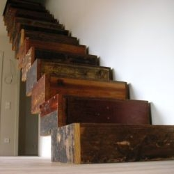 """Jan Korbes' Garbage Architecture in The Netherlands focuses on: """"objects interiors research and workshops based on recovered waste materials"""". One example is a set of stairs made from woods reclaimed from an old castle."""
