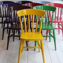 """London designer Christopher Howe's custom-painted Windsor chairs are all about the paint. """"We should all have at least one in a heart-rending color,"""" Howe says."""