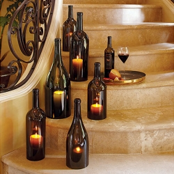 100% authentic over-sized wine bottles slip over candles and glow with a flickering internal candlelight.