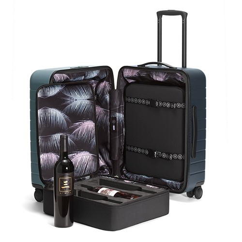 Away's Dwyane Wade Wine Case. This hardshell carryon includes two removable foam case inserts that carry 3 bottles of wine each and a limited edition color and palm frond fabric interior.