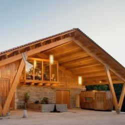 Portuguese architects Castanheira & Bastai have designed the Adega Casa da Torre, a winery in Louro, Vila Nova de Famalicão, Portugal.