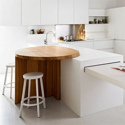 This counter height wood breakfast nook is a beautiful juxtaposition to the clean modern kitchen island - from Elmar.