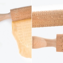 Tasty Calendar - An advertisement for World Wide Bakery ~ great use of a rolling pin!