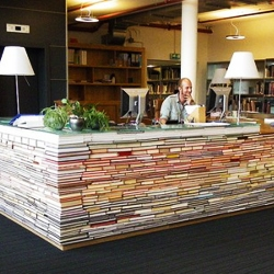 The information desk at TU Delft architecture bibliotheek is made of books.