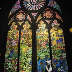 'Stained Window', a collaboration between renowned street artist Banksy and students at the City of Angels public school in Los Angeles.
