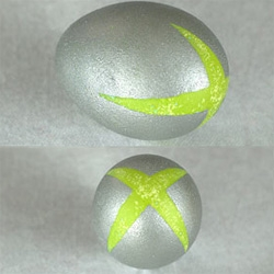 "On impressive egg paint jobs... xbox egg? And as kotaku says, you need the wii and ps3 ones ""But, to make it true to life you'll have to hide the Wii egg where no one can find it and leave the PS3 egg out in the open where no will want to find it."""