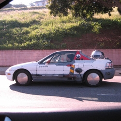 Honda del Sol (circa 1994) that has been completely outfitted to match Luke's X-Wing from A New Hope. From the accurately detailed R2 unit in the back to the side mounted guns with laser burns scorching the car near the tips, this is clearly the work of some mad genius.