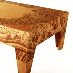 I love the Yazuka table, with traditional japanese tattoos printed on the surface of the wood.