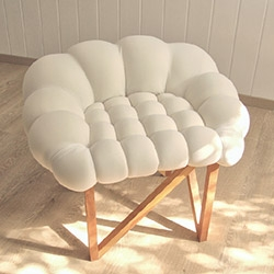 SNÖBÄR is Swedish word for snowberry. A play on word, shape and material for the soft berry seating shape, constructed from of oak.